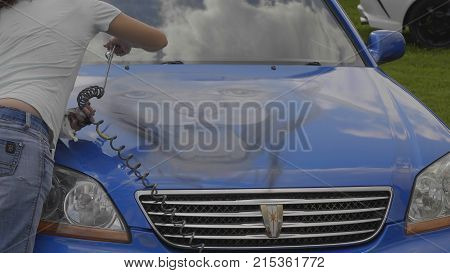 BARNAUL - AUGUST 22: Day of the city. Application of airbrushing on the hood of the car on August 22 2017 in Barnaul Russia.