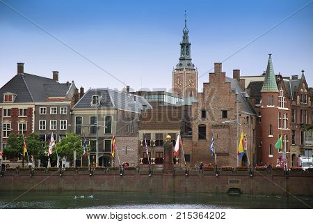 The Hague The Netherlands - August 18 2015: View on Buitenhof street and Grote of Sint-Jacobskerk (Big church) from The Binnenhof Palace in The Hague Netherlands on August 18 2015.
