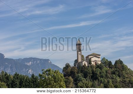 Castle on the hill landscape mountains and peaks in background. Trentino South Tirol Castello Molina Di Fiemme Alto Adige Italy - Saint George Church