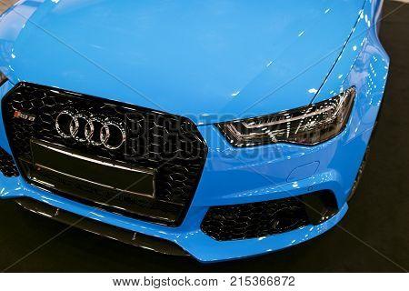 Sankt-Petersburg Russia July 21 2017: Front view of a blue modern luxury blue sport car Audi RS 6 Avant Quattro 2017. Car exterior details. Photo Taken on Royal Auto Show July 21