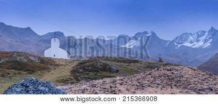 Church on the hill landscape mountains and peaks in background. Silvretta High Alpine Road Austria - Barbara Chapel