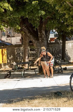 SAULT FRANCE - JUNE 25 2017: Couple playing petenque boules in Sault. Provence France.