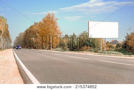 Horizontal shot of billboard on the background of forest and sky advertising space space for notes copy space background