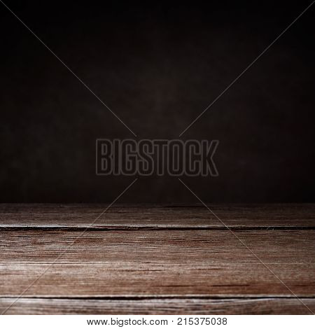 Square shot of elegant brown wooden texture on a brown background with copy space. Wooden background.