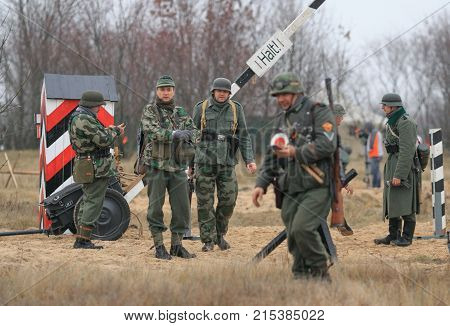 Gomel, Belarus - November 26, 2017: Re-enactors Dressed As German Soldiers In Ww Ii Are Fighting Wit