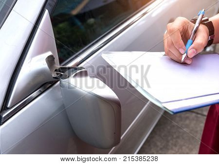 Insurance Officer Checking car accident,Car accident broken side mirror.