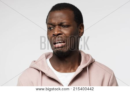 Disguting! Shocked Young African American Man Looking At Something Unpleasant And Bad, Isolated On G