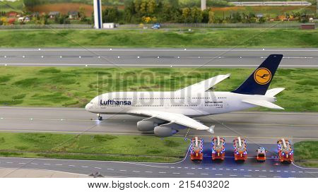 HAMBURG, GERMANY - MARCH 8th, 2014: An Lufthansa Airbus A380 taxiing to runway with fire department in hold at Flughafen Wunderland. Up to 40 different aircrafts, from Cessna to Airbus A 380, are taxing independently on Knufingen Airport at Miniatur Wunde
