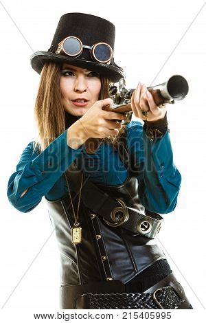 Young steampunk islolated girl on white wearing fancy hat. Fantasy old fashion with stylish topper goggle and gun aiming. poster