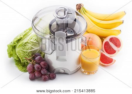 juicer machine with fruits and vegetables isolated on white background