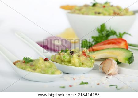 Tortilla guacamole dip in white bowl and spoons. Fresh Vegetable dip.