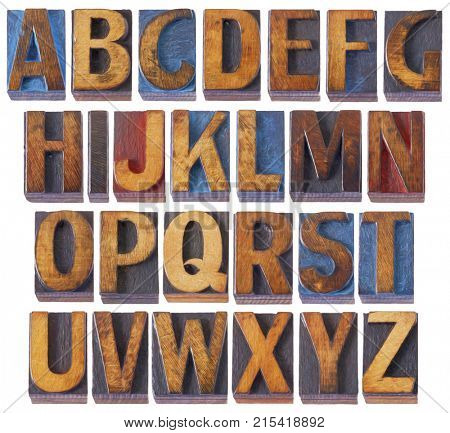 complete English alphabet set - collage of 26 isolated vintage wood letterpress printing blocks, scratched and stained by blue, red and black ink, digital painting filter applied