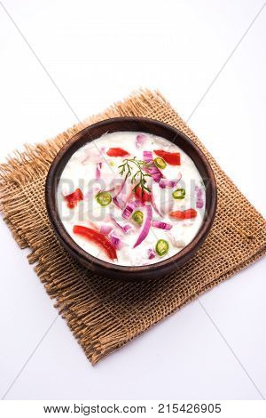 Onion Raita pyaj or kanda Koshimbir Indian onion salad is a condiment from the Indian subcontinent, made with dahi or curd together with raw or cooked vegetables like onion, tomato, green chili and coriander