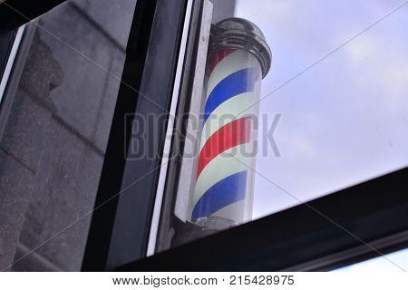 Barber Shop Pole. Symbol of a barbershop Lamp