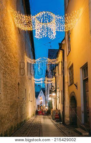 Tallinn, Estonia. View Of Raekoja Street In Christmas New Year Xmas Festive Illumination Lights And Decorations.