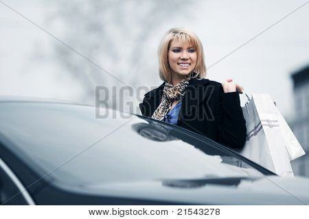 Young shopper on a car parking
