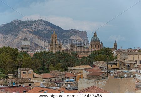 Sicilian Town Of Palermo Skyline Over Roofs Of Historic Buildings With The Mountains In The Backgrou