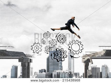 Business woman jumping over gap with gear mechanism in concrete bridge as symbol of overcoming challenges. Cityscape on background. 3D rendering.