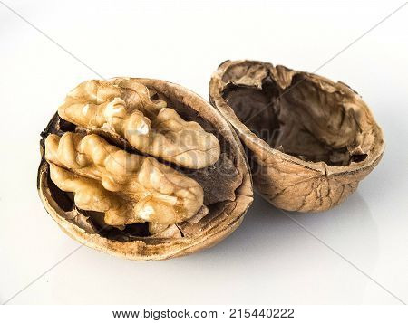 shelled walnut and clean walnut, shelled walnuts on white ground, dry walnut on wooden floor,