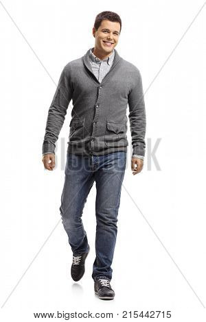 Full length portrait of a guy walking towards the camera isolated on white background
