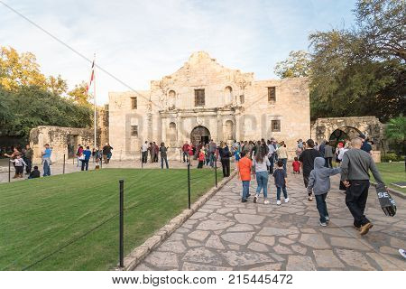 Visitors At Entrance Of The Alamo Mission In San Antonio