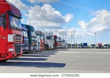 St. Petersburg Russia - July 27 2017: A fleet of trucks with a trailer parking in the territory of a logistics terminal.