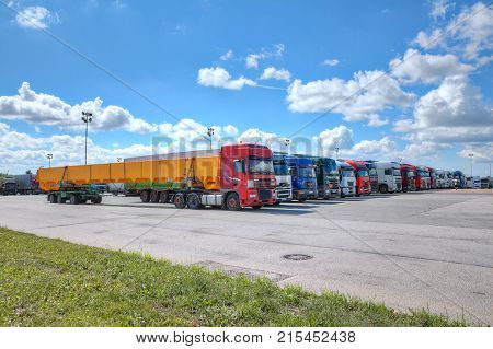 St. Petersburg Russia - July 27 2017: Fleet of trucks a lot of trucks parked in the yard of a logistics park.