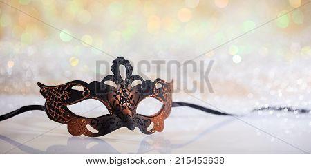 Black Carnival Mask On Bokeh Background