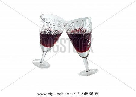 clinking vintage faceted crystal glasses (no hands) with red wine isolated