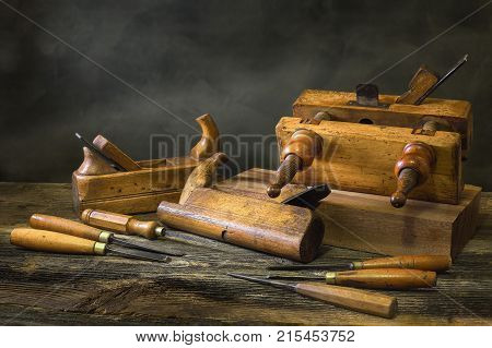 Still life with carpentry tools bench planes of the joiner wood carving chisel