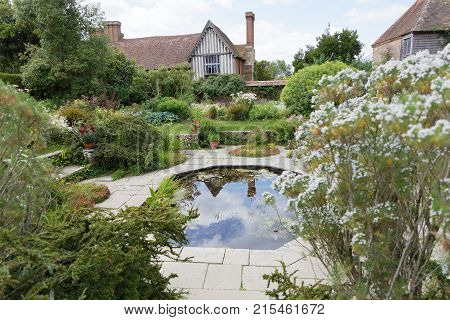 NORTHIAM GREAT BRITAIN - JUN 06 2017: Pond with flowers and plants and buildings in the background. June 06 2017 in Northiam Great Britain