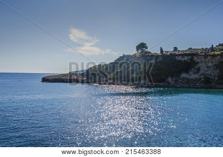 outgoing promontory near the beach of Pessada at sunset in the Ionian Sea