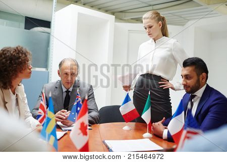 Young Russian representative presenting her speech to foreign colleagues at political event