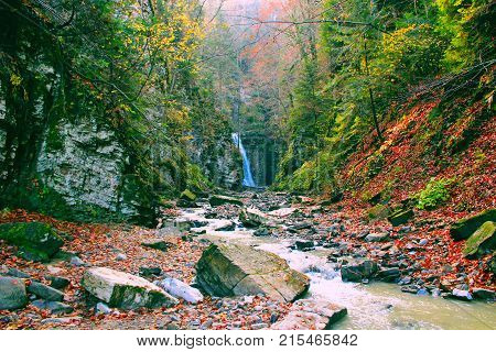 landscape with a waterfall and a mountain river in autumn. Autumnal lanscape in mountains