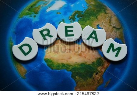 word dream on an  abstract colored background