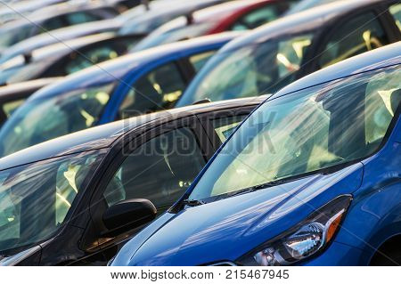Car Industry Concept. Brand New Cars in Stock. Transportation Business Theme.