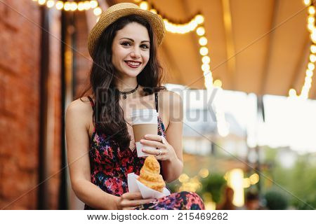 People, Food, Rest And Lifestyle Concept. Brunette Woman With Long Hair, Wearing Summer Dress And Ha