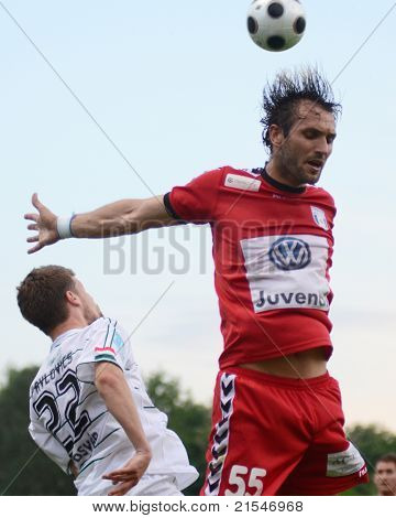 KAPOSVAR, HUNGARY - MAY 14: Gosic Dragan (in red) in action at a Hungarian National Championship soccer game - Kaposvar vs Szolnok on May 14, 2011 in Kaposvar, Hungary.