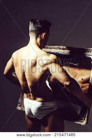Handsome Muscular Bodybuilder At Mirror