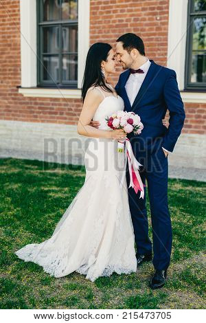 Affectionate Wedding Young Couple Going To Kiss, Being Happy To Celebrate Their Wedding. Lovely Brun