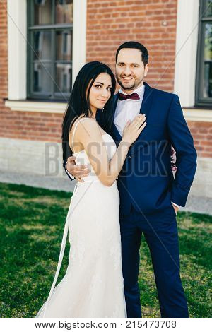 Romantic Couple In Love Celebrate Their Wedding, Embrace Each Other Affectionately, Have Happy Expre