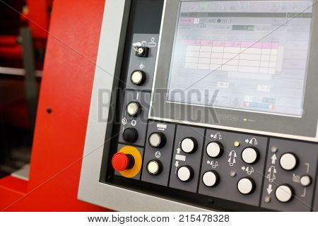 Control panel of the CNC automatic band saw stainless steel rod cutting machine. Selective focus.