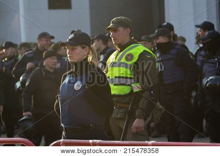 Kiev Ukraine - October 18 2018: Police woman standing in cordon guarding the parliament building