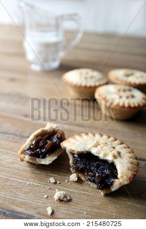 Selection Of Several Mince Pies, Some Broken Open Or Partly Eaten. A Traditional Festive Christmas D