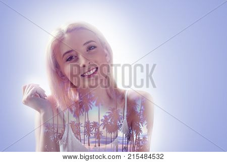 Beautiful smile. Happy nice positive woman smiling and looking at you while thinking about the vacation