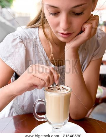 Woman Is Stirring Coffee