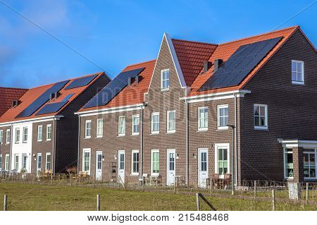 Modern Row Houses With  Solar Panels On Sunny Day