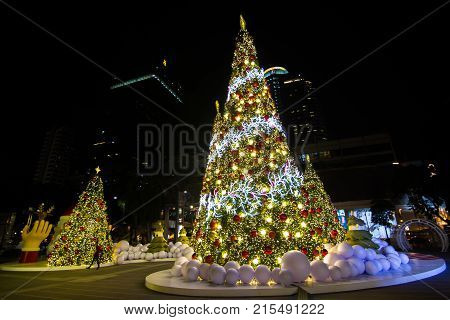Bangkok Thailand:- Nov18,2017:- Christmas trees adorn and Strap Accessories Ornaments Christmas with gift box on Christmas the front of the World Trade Center,  Many people are happy. In the Christmas