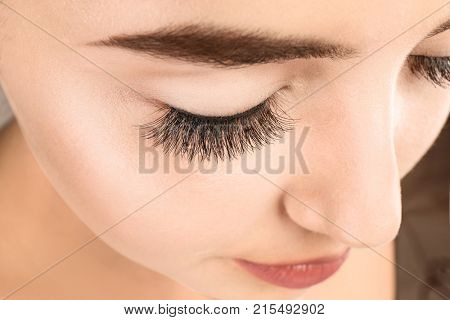 Beautiful young woman with eyelash extensions, closeup