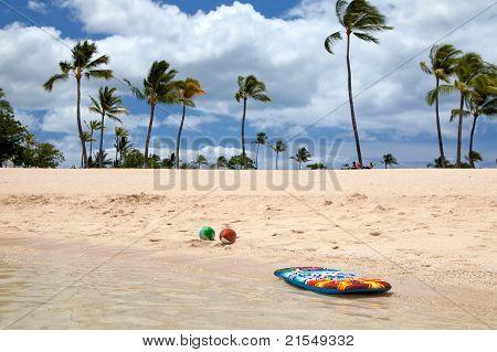 Boogie Board And Beach Balls On A Beautiful Tropical Beach